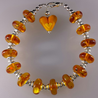 Amber and silver bracelet with heart bead dangle