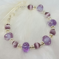 Pale pink and mauve lampwork glass bracelet