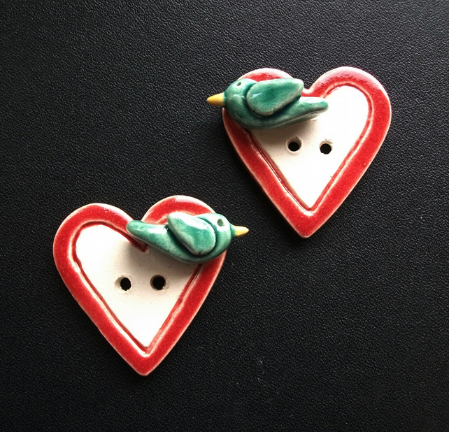 Set of two large ceramic heart buttons with sculpted birds