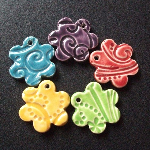 Set of five multicoloured ceramic charms