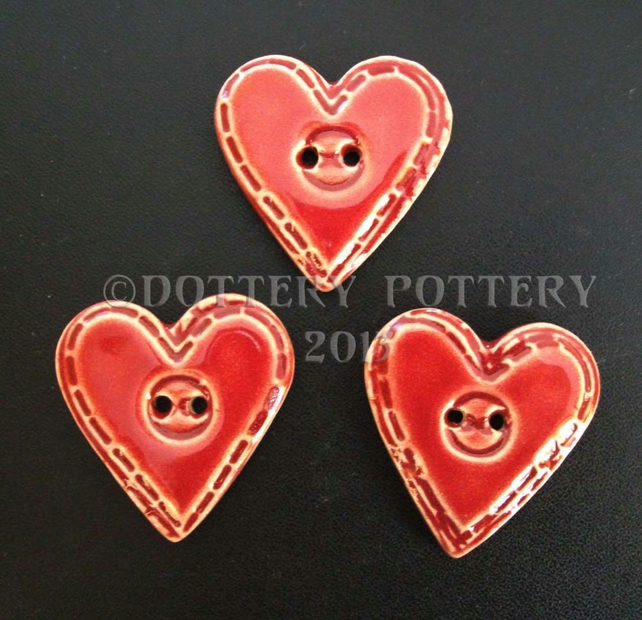 Set of three large red ceramic heart buttons