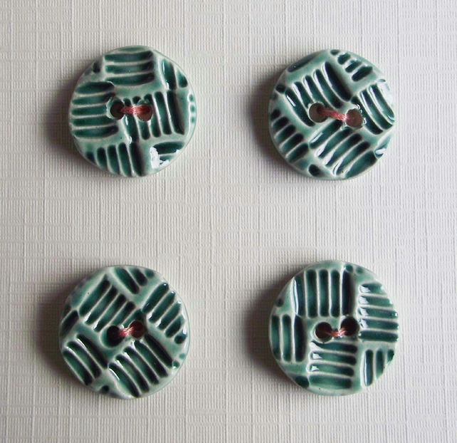 Set of four little handmade ceramic buttons