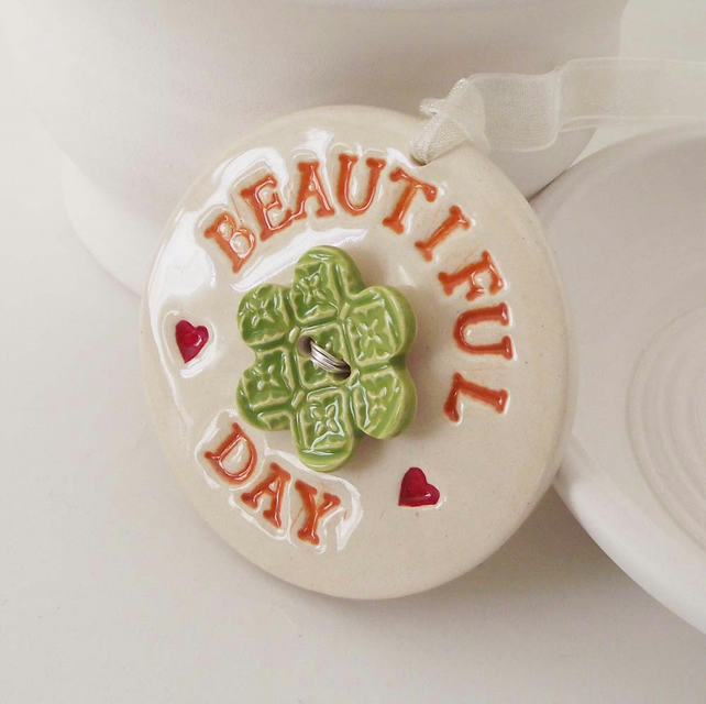 Ceramic Beautiful Day decoration with flower button