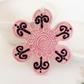 Pink ceramic flower decoration.