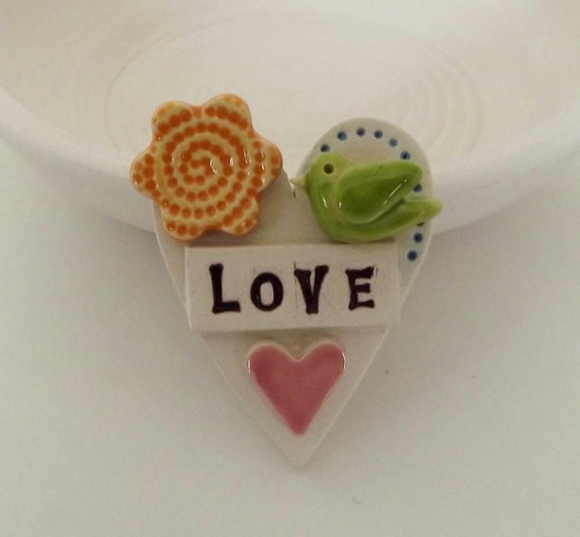 Tiny, teeny bird Loveheart ceramic brooch