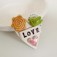 Tiny, teeny bird Loveheart ceramic brooch pottery bird