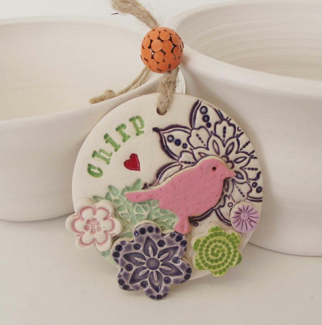 Ceramic decoration with bird and flowers