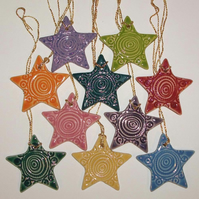 Brightly coloured ceramic star Christmas decorations - lucky dip.
