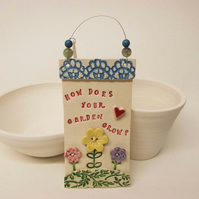 Ceramic How Does Your Garden grow wall plaque Pottery