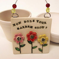 Ceramic How Does Your Garden grow wall plaque