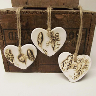 Set of three natural flower ceramic heart decorations Pottery