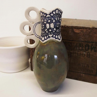 Small pottery jug lace decoration. Ceramic kitchenware, Vase