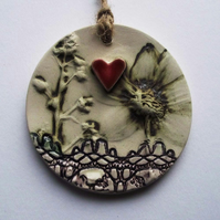 Pottery decoration with natural flower and loveheart decoration.