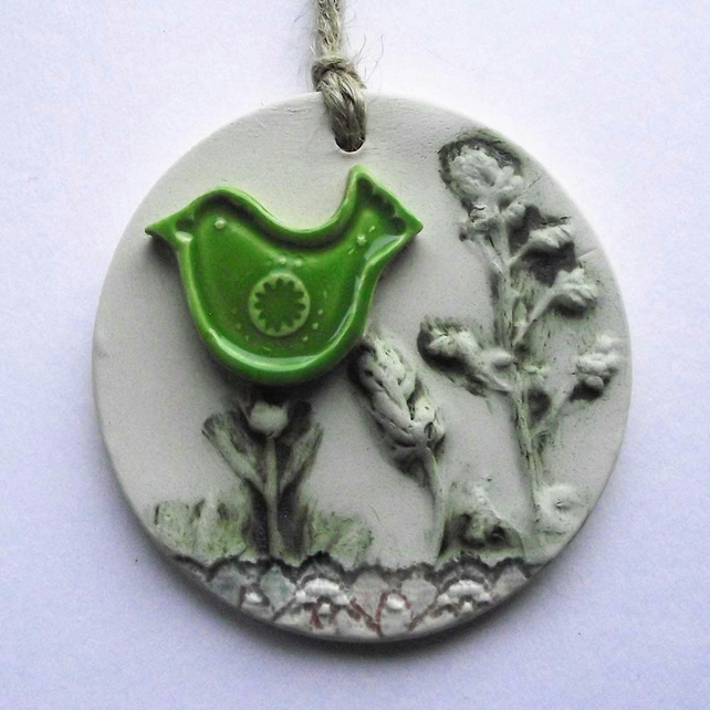 Pottery decoration with natural flower and green bird decoration.