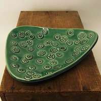 Green Pottery Dish with detailed pattern. ceramic.