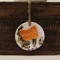 Pottery decoration with natural flower and butterfly motif.