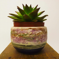 Pottery hand thrown bowl with purple interior