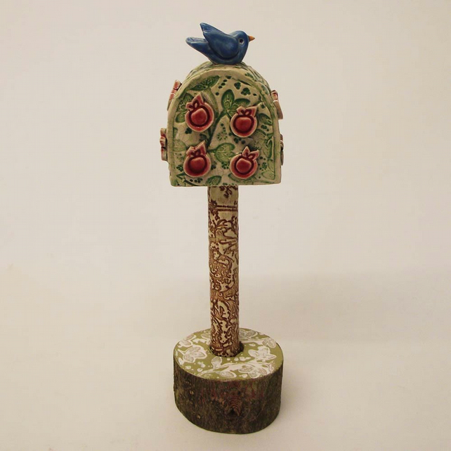 Pottery bird in an apple tree Ceramic sculpture