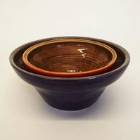 Set of two useful pottery stacking bowls. Retro 1970's inspired