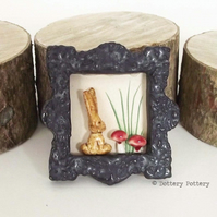 Little ceramic bunny rabbit brooch with toadstools Pottery jewellery.