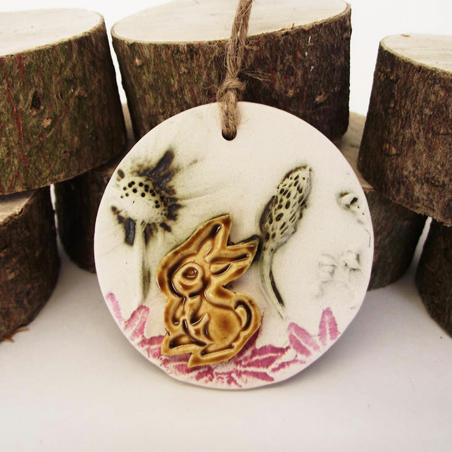Sale Pottery decoration with natural flower and rabbit motif.