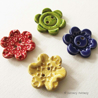 Set of four large flower ceramic buttons bright colours