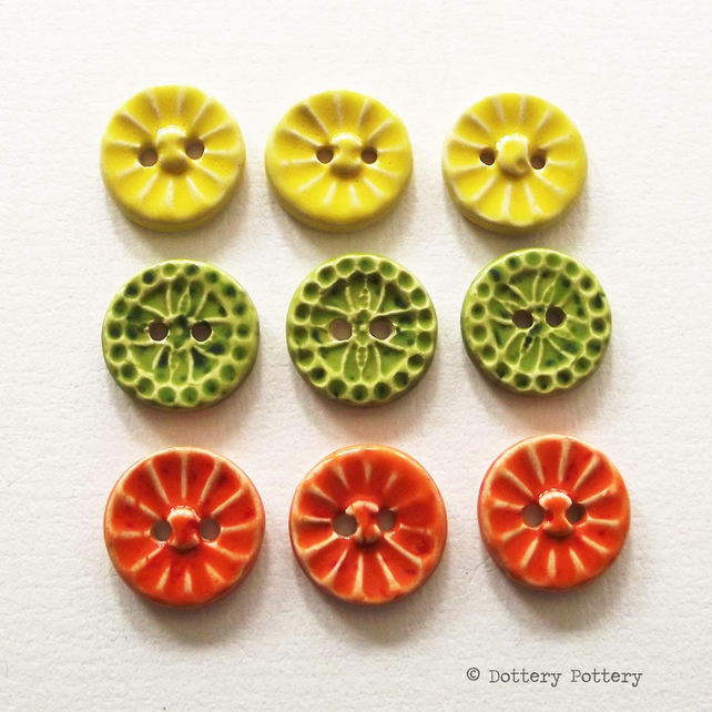 Set of nine little handmade ceramic buttons citrus colours