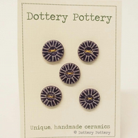 Set of five little handmade ceramic buttons