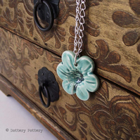 Pottery Flower pendant on 20cm chain. Ceramic Flower natural print
