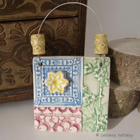 Small decorative ceramic tile with handmade beads patchwork design