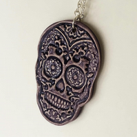 Pottery purple skull pendant on 20 inch chain. Ceramic skull Day of The Dead