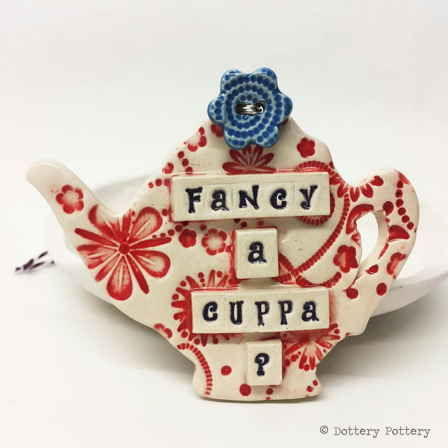 Ceramic teapot decoration with flower button pottery