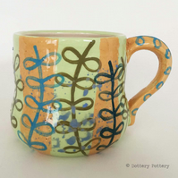 Handthrown pottery mug handpainted leaf design ceramic mug