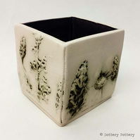 Small ceramic slab pot with natural flower design and purple interior