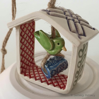 Small decorative pottery birdhouse hanging decoration with ceramic bird and bead