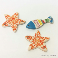 Ceramic starfish and fish beads suitable for jewellery making