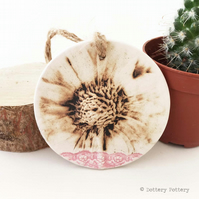 Pottery decoration with natural flower design.