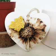 Pottery heart decoration with natural flower design and bee