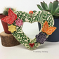 Heart shaped Ceramic floral wreath decoration with butterflies and flowers