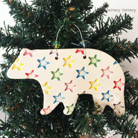 Ceramic Polar Bear with bright star design. Pottery Christmas decoration bear