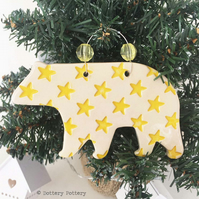 Ceramic Polar Bear with yellow star design. Pottery Christmas decoration bear