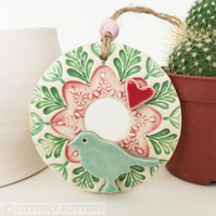 Small ceramic floral wreath decoration with bird and heart pottery bird
