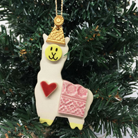 Pottery llama hanging decoration Llama in a party hat