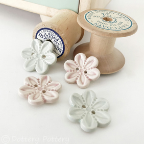 Set of four flower shaped ceramic handmade buttons