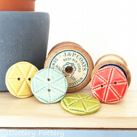 Set of four bright ceramic handmade buttons