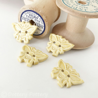 Set of four little ceramic bee handmade buttons