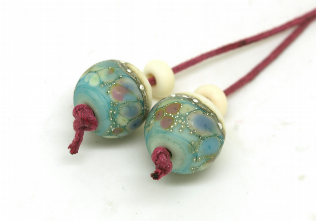 Lampwork Bead Pair in Green & Ivory with Pastel Shades.