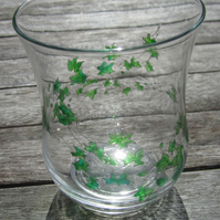 Hand painted strands of ivy with iridescent leaves on glass vase