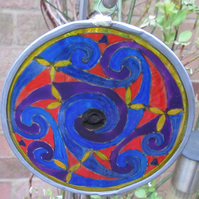 Suncatcher - Celtic Spirals - blues, purples and red with yellow border