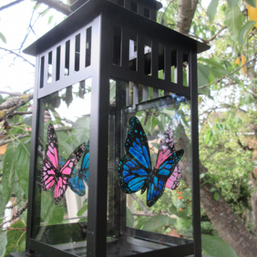 Lantern with hand painted pink and blue Butterflies on the glass panels